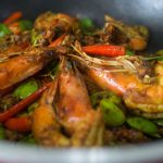 thai stir fried stink beans with shrimp in a pan