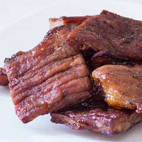 Thai beef jerky or nuea kemon a white plate