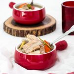 pork rib tom yum in red bowls