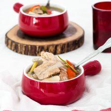pork rib tom yum in red bowls