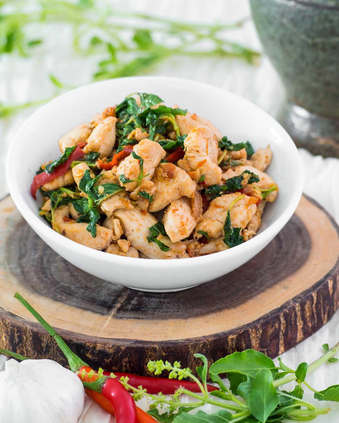 thai holy basil chicken or pad kraprao gai in a white bowl