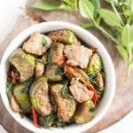 a bowl of thai eggplant stir-fried with salted soy beans and Thai basil