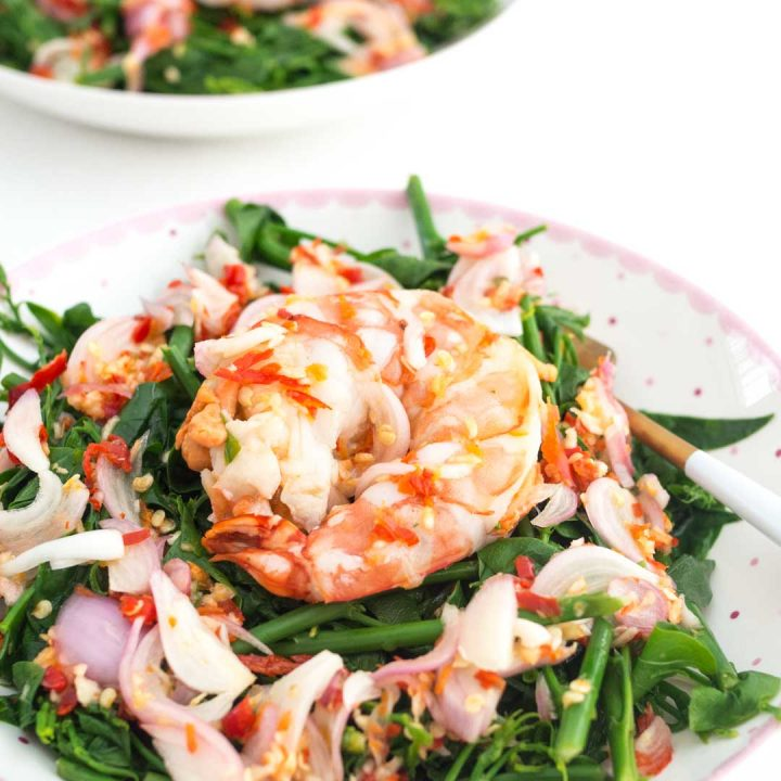 two bowls of spicy Thai sweet leaf salad with shrimp