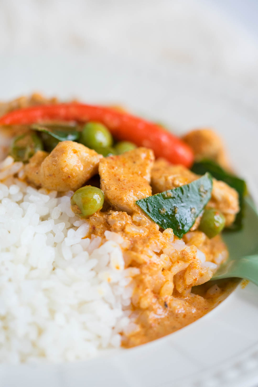 a close up of rice with Thai chicken panang curry