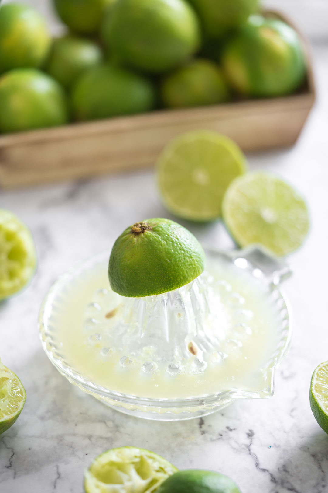 lime juice in a glass juicer