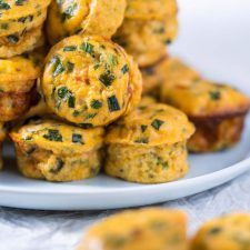 a pile of cottage cheese egg muffins on a blue plate