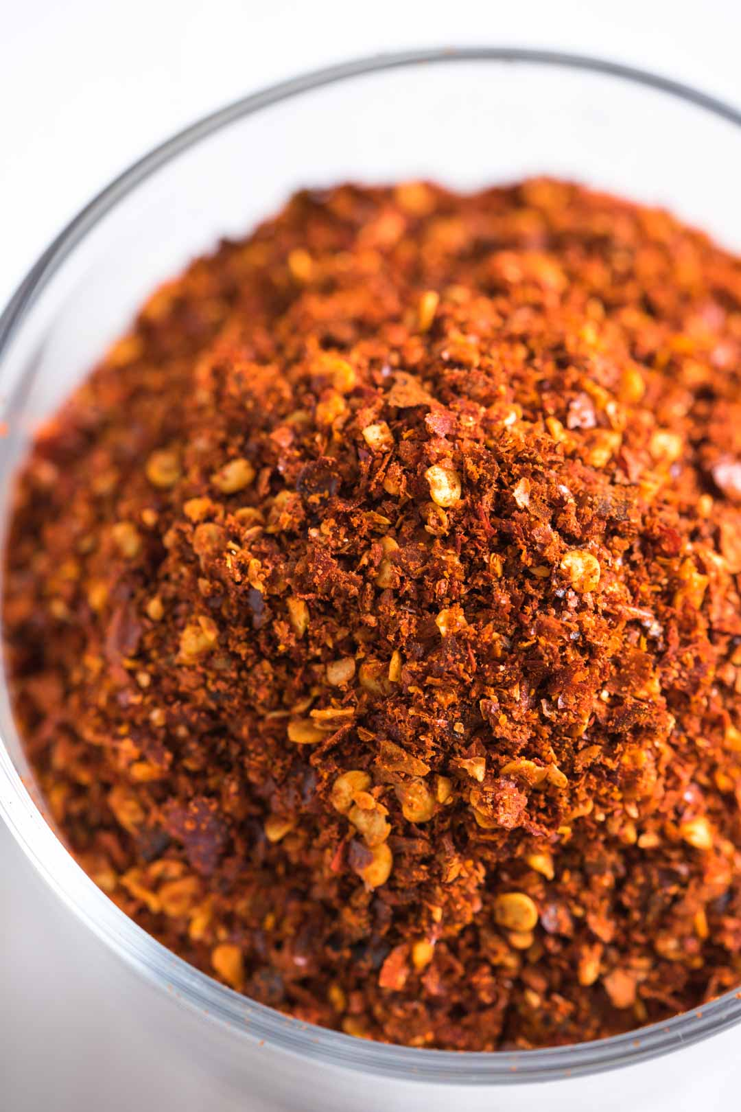 a top view of roasted Thai chili flakes in a cup