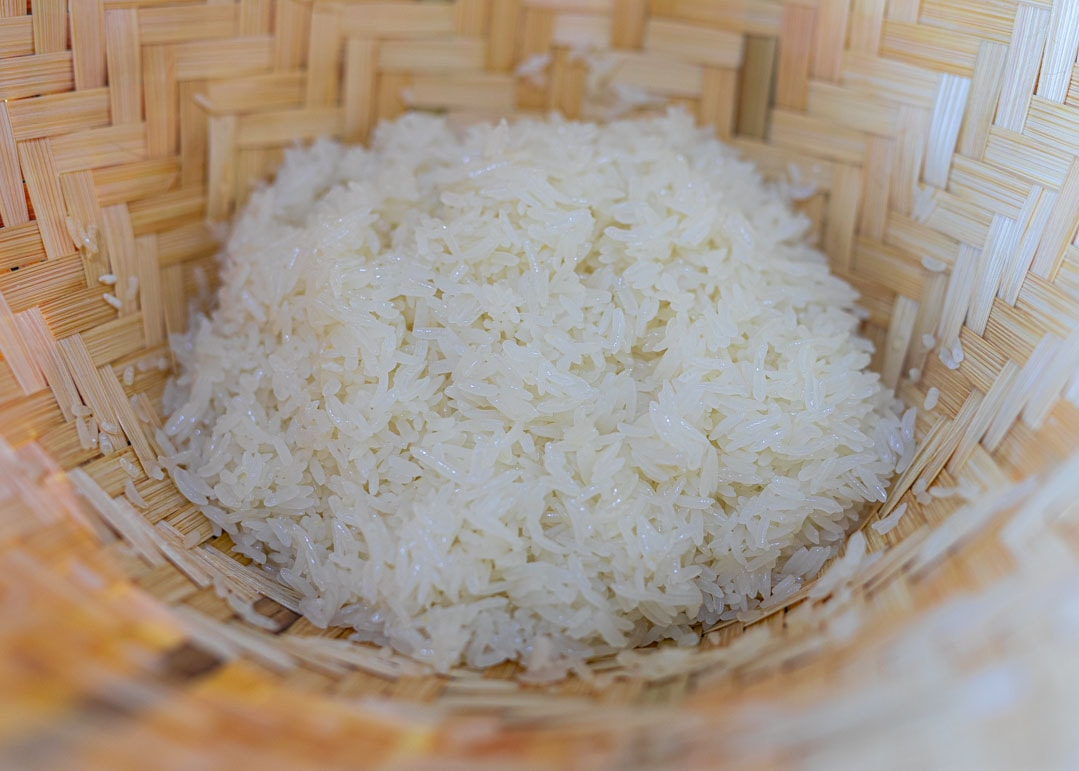 cooked Thai sticky rice in a bamboo steamer basket