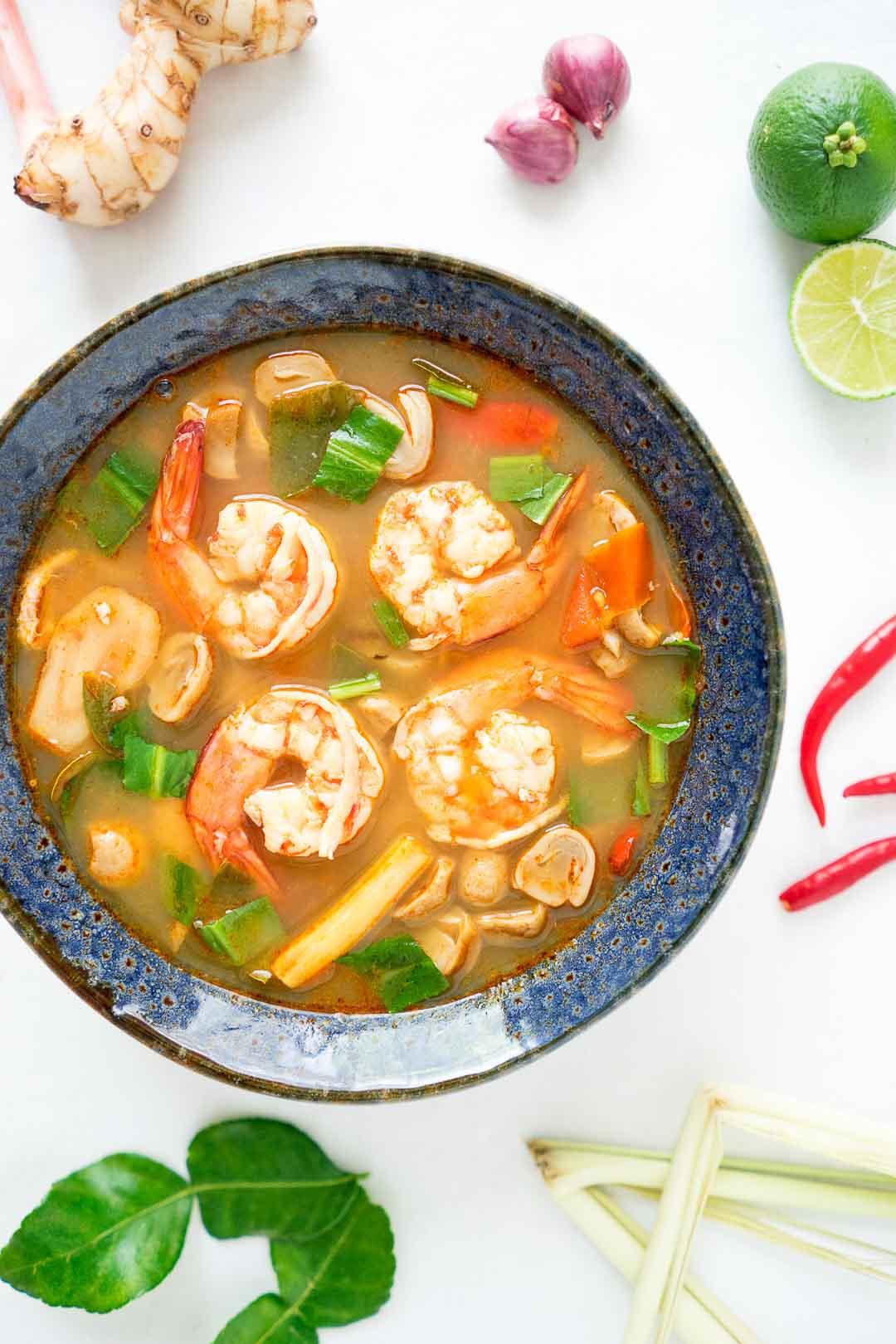 a bowl of tom yum goong or Thai lemongrass soup | tom yum gung | ต้มยำกุ้ง