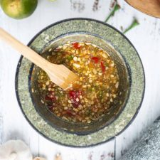 thai spicy and sour salad dressing in a mortar