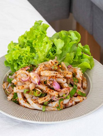 a plate of Thai vegan larb (laab) with konjac noodles on a table