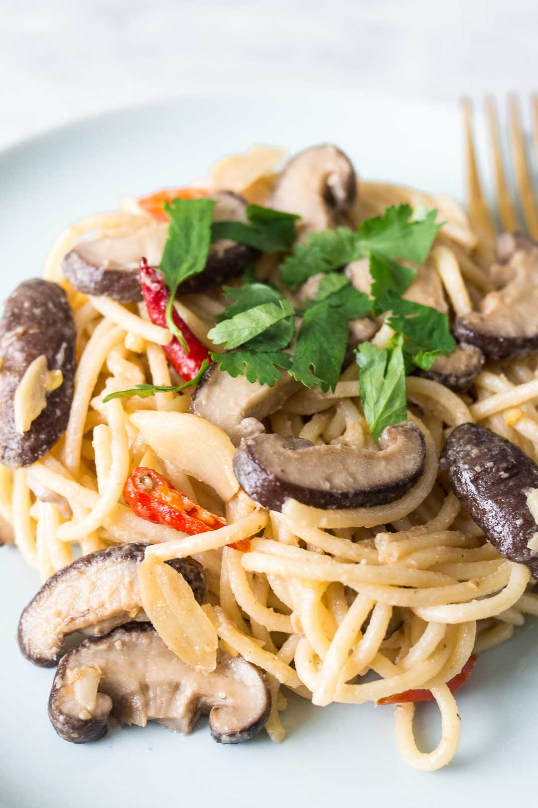 miso pasta with shiitake mushrooms in a blue dish