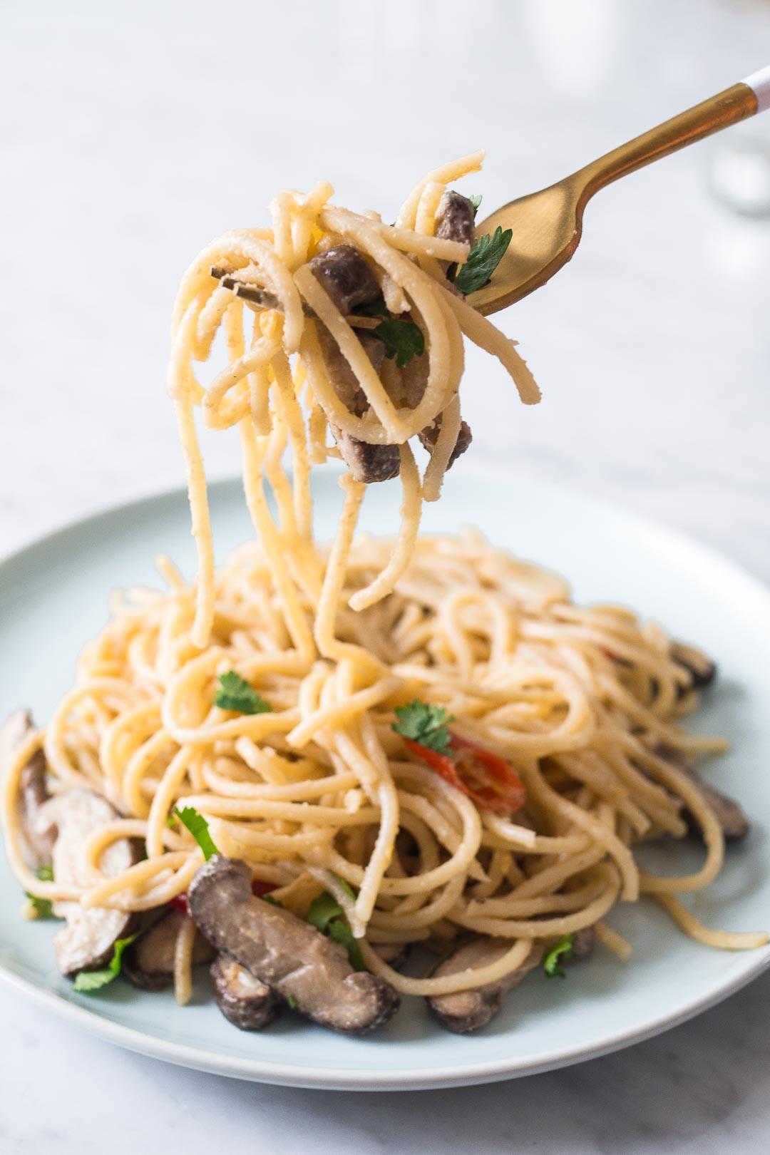 miso mushroom pasta in a blue dish