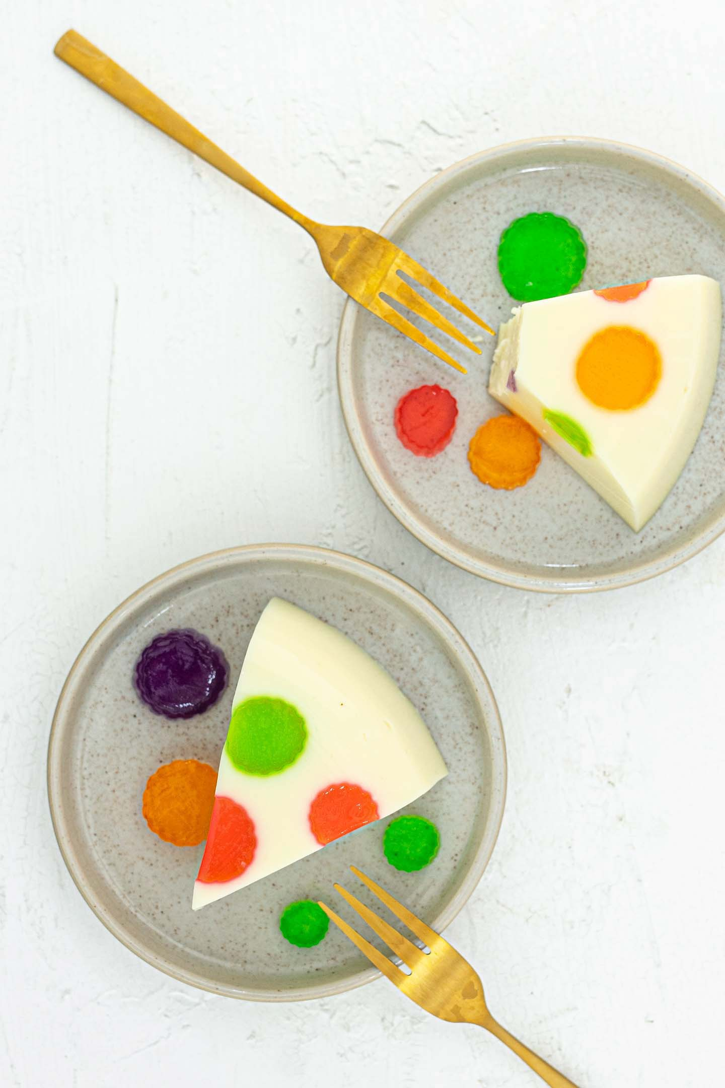 two slices of polka dot jelly cake on two plates