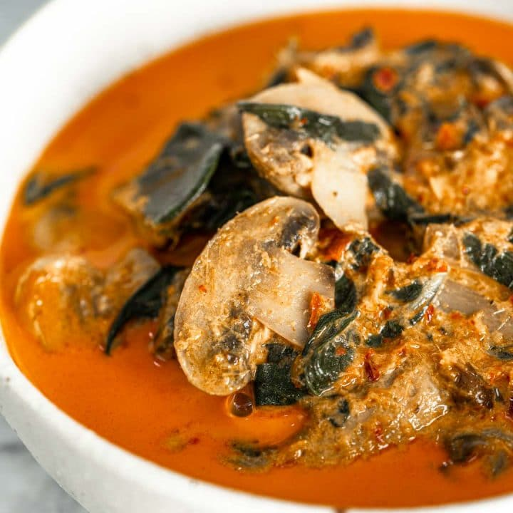 a bowl of vegan Thai red curry with mushrooms