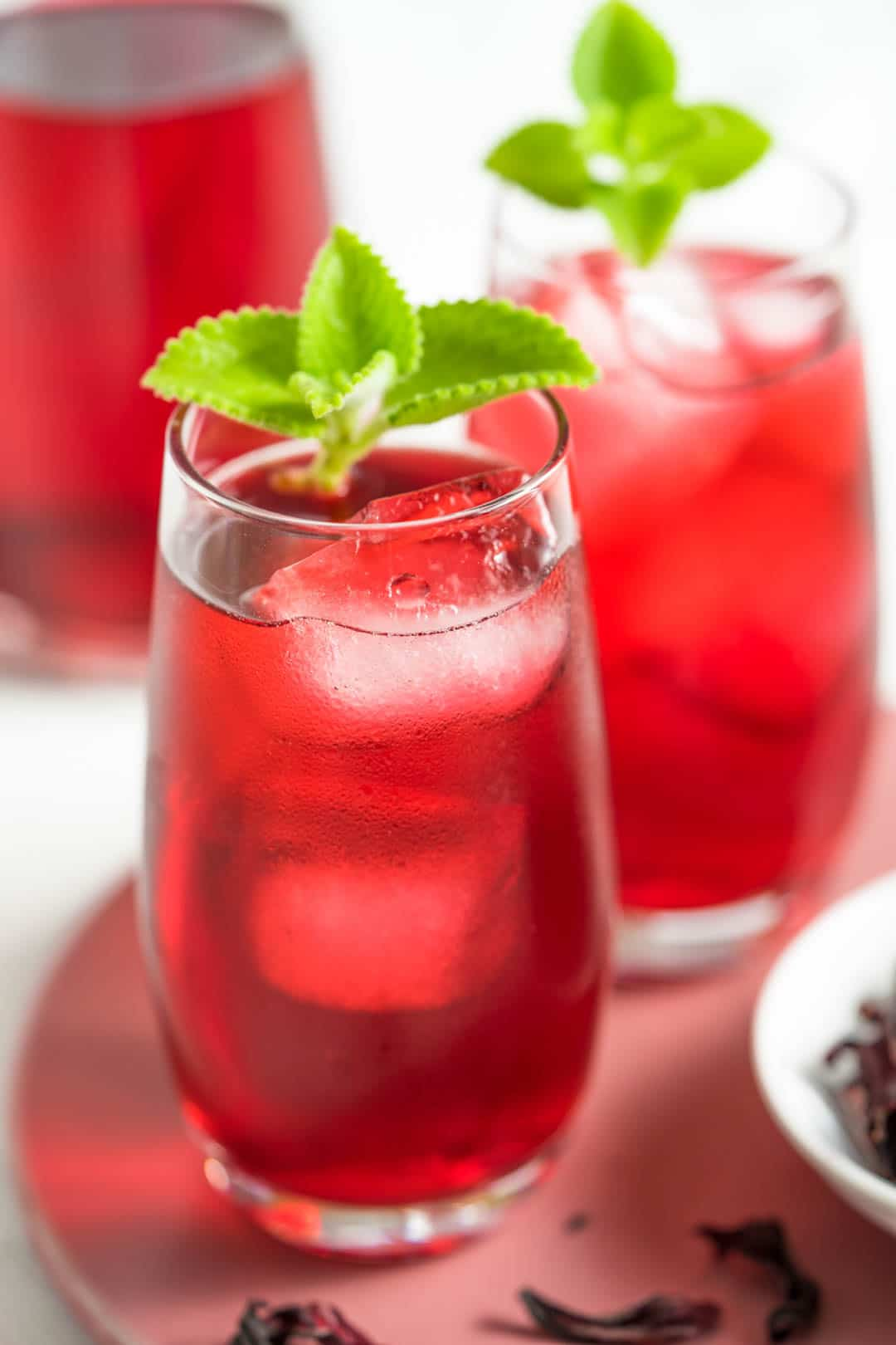 two glasses of iced hibiscus drink