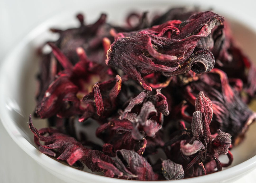 dried roselle flowers in a bowl