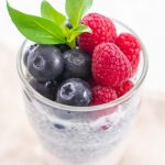 chui pudding with strawberry yogurt, blueberries and raspberries in a glass