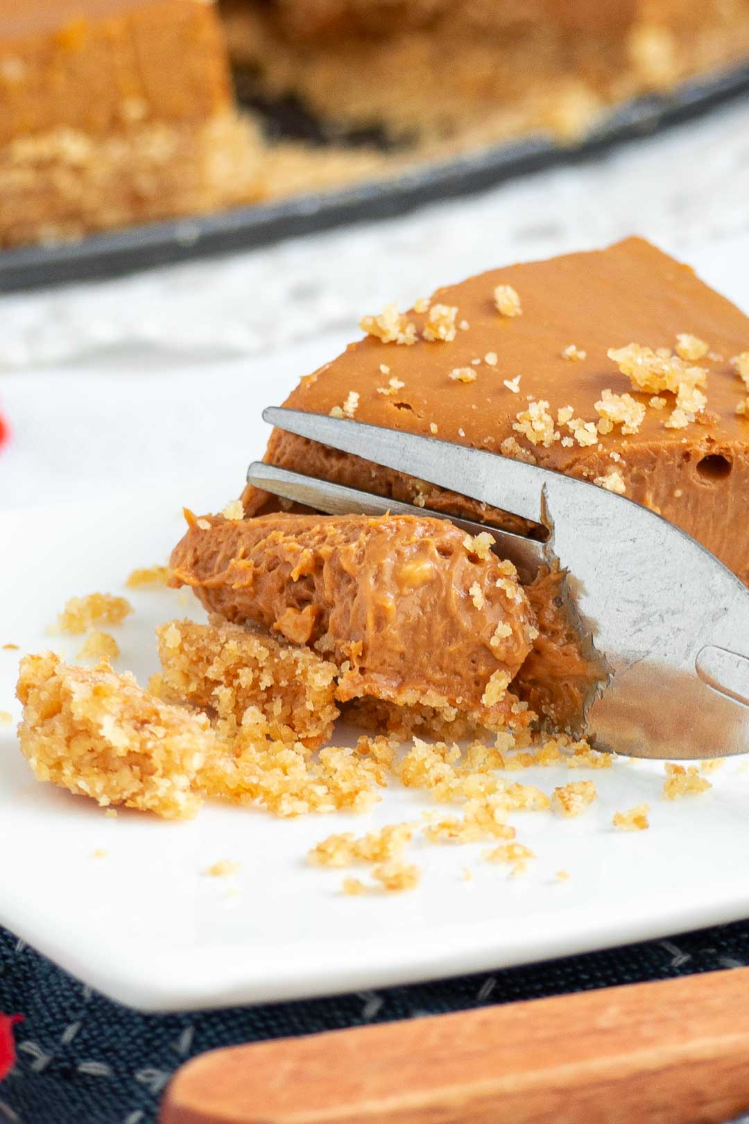 a close up of a bite of Thai tea cheesecake