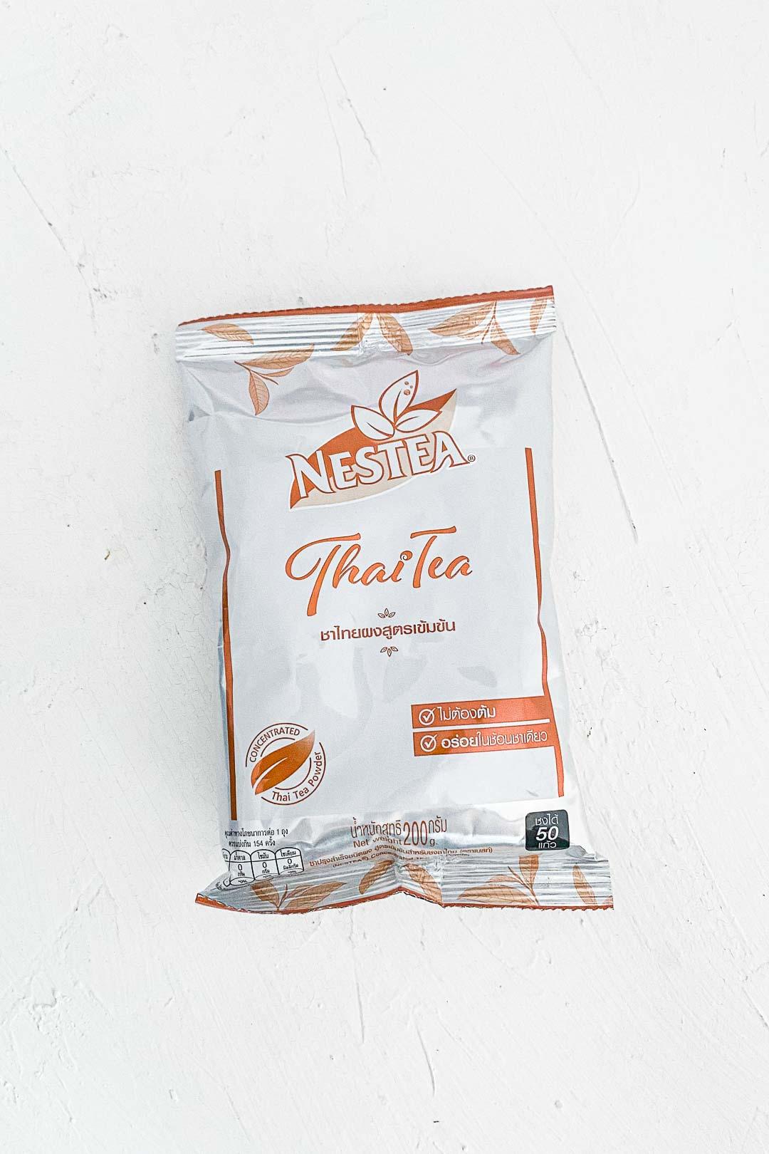 a bag of NESTEA concentrated Thai tea powder