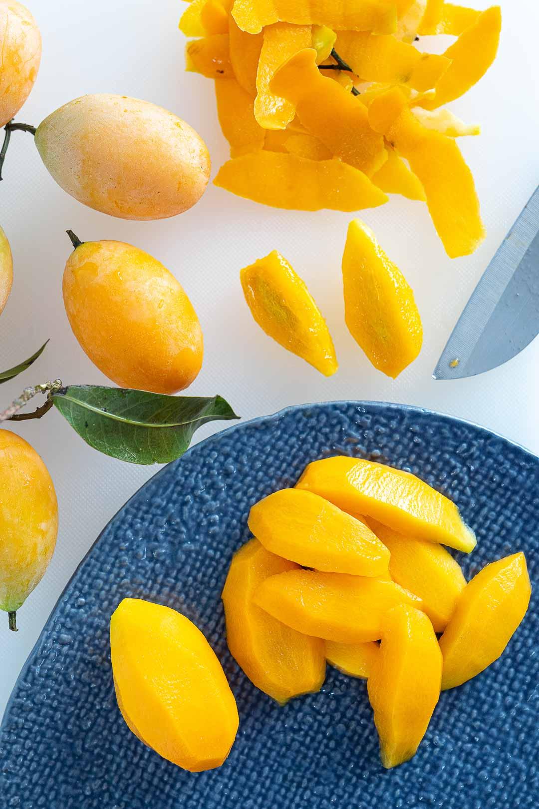 fresh plum mangos ready to eat - มะยงชิด