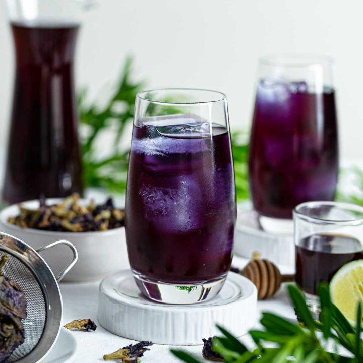 Two Glasses And One Pitcher Of Butterfly Pea Tea or Blue Tea