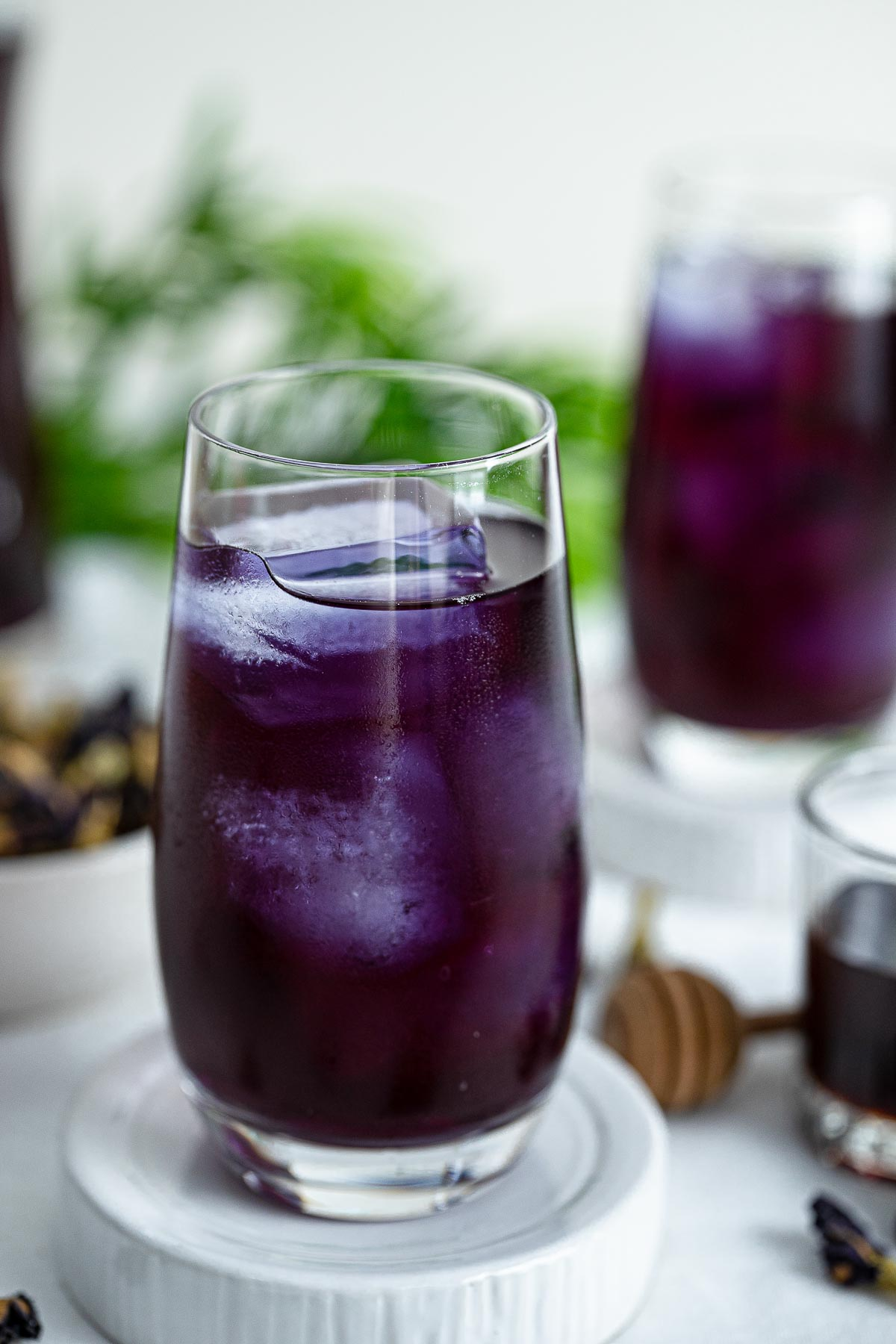 two glasses of iced butterfly pea tea